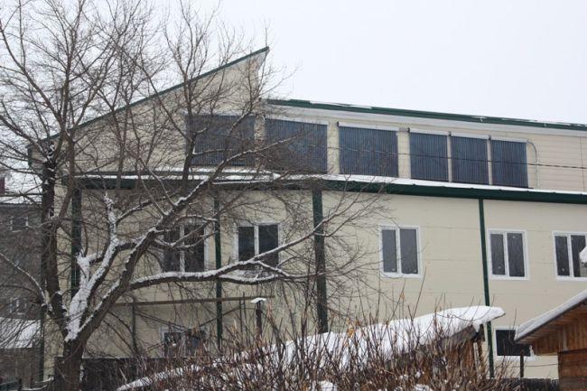 Установка солнечных коллекторов на фасаде здания